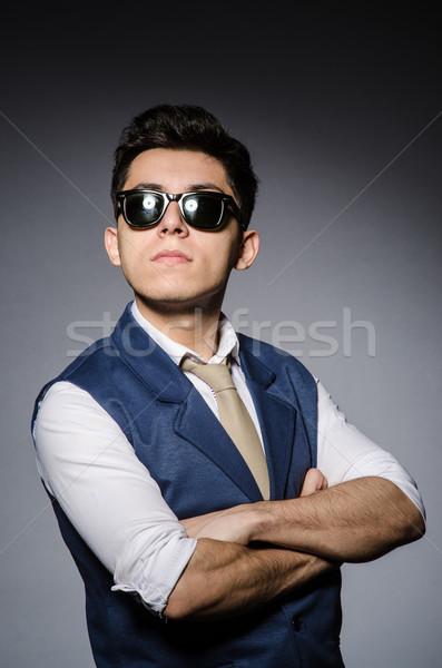 Jeune homme bleu gilet gris modèle noir Photo stock © Elnur