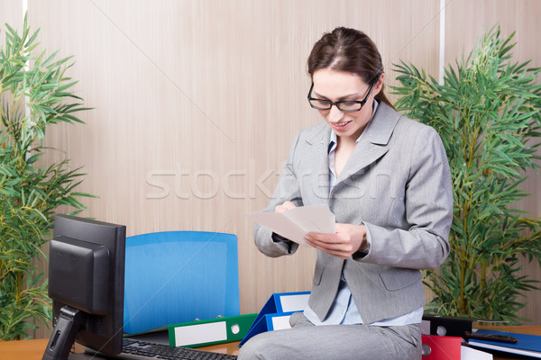 Office woman making paper airplanes Stock photo © Elnur