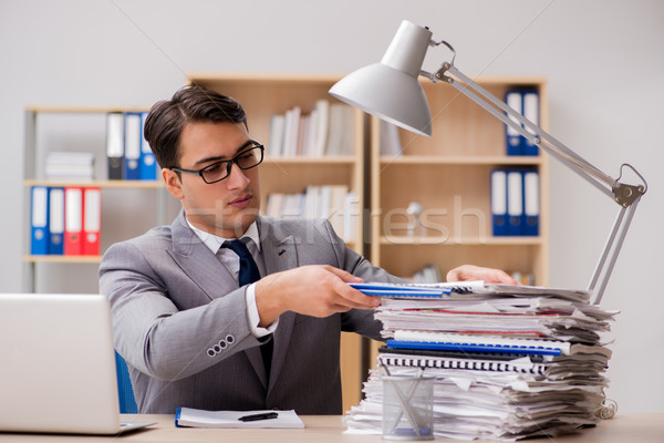 Handsome businessman working in the office Stock photo © Elnur