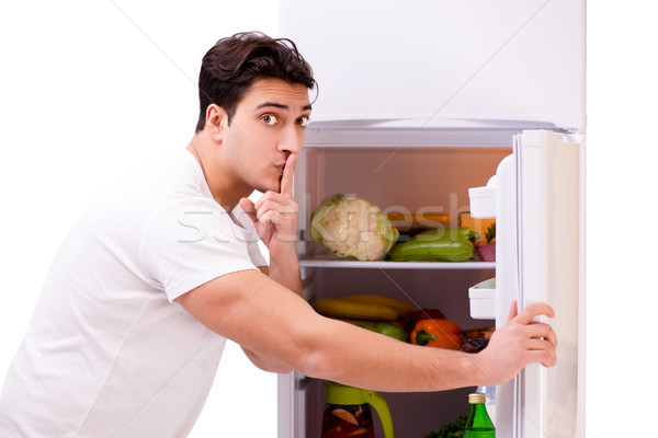 Man next to fridge full of food Stock photo © Elnur