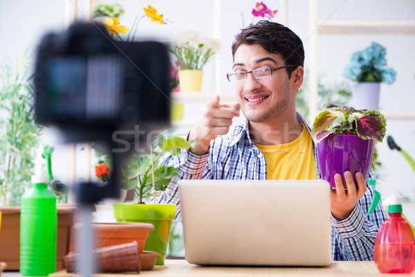 The man florist gardener vlogger blogger shooting video on camera Stock photo © Elnur
