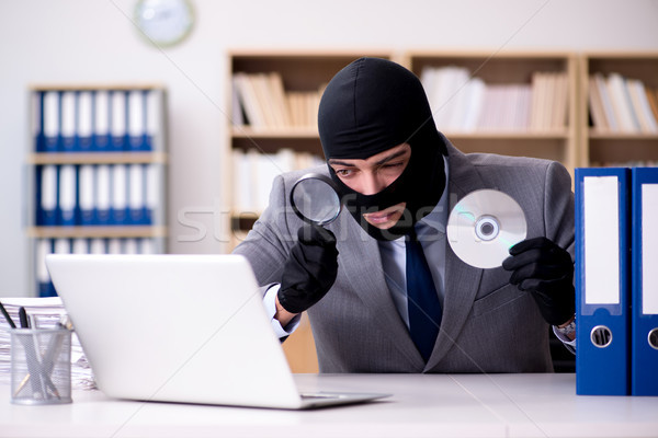 The criminal businessman wearing balaclava in office Stock photo © Elnur