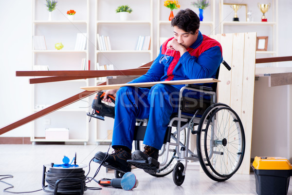 Disabled man working with circular saw  Stock photo © Elnur