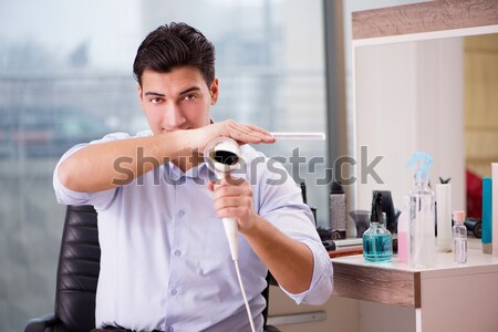 The young handsome man shaving in the morning Stock photo © Elnur