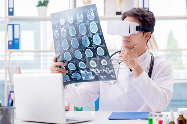 Doctor working with virtual VR reality glasses Stock photo © Elnur