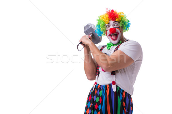 The funny clown with a hammer isolated on white background Stock photo © Elnur