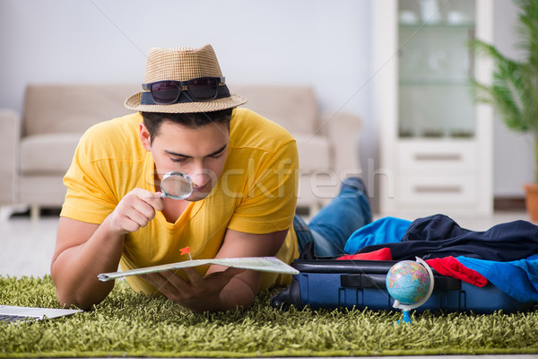 Man planning his vacation trip with map Stock photo © Elnur