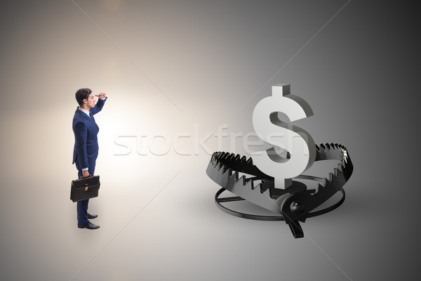 Businessman being trapped by dollar Stock photo © Elnur