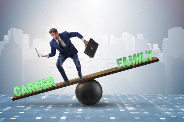 Businessman balancing between career and family in business conc Stock photo © Elnur