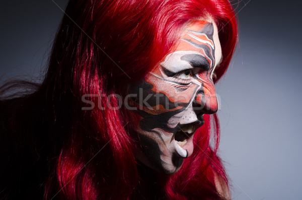 Woman with face painting in dark room Stock photo © Elnur