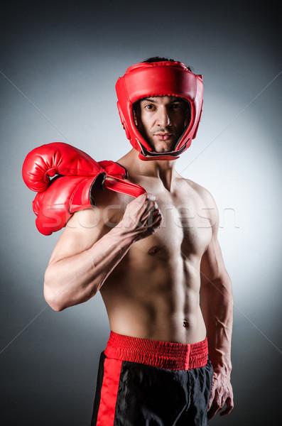 Muscular boxeador rojo guantes mano deporte Foto stock © Elnur