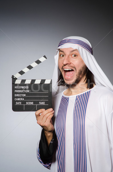 Arab businessman with movie board Stock photo © Elnur
