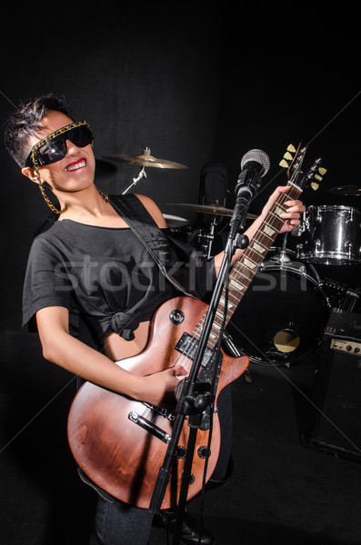 Young woman playing guitar during the concert Stock photo © Elnur