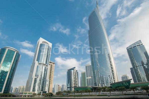 Tall skyscrapers in Dubai near water Stock photo © Elnur