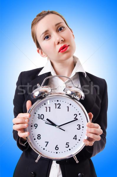 Woman businesswoman with giant clock Stock photo © Elnur
