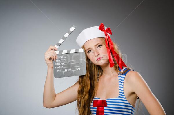 ストックフォト: 若い女性 · 船乗り · 映画 · ボード · 幸せ · 芸術