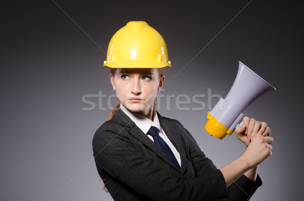 Female engineer with helmet isolated on gray Stock photo © Elnur
