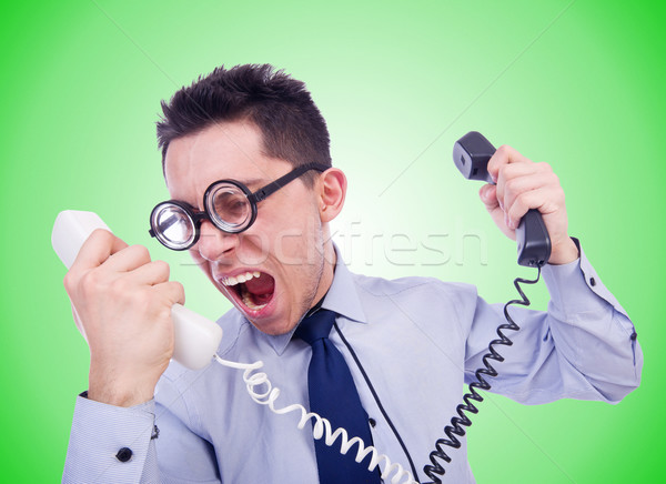 Crazy man with phone on white Stock photo © Elnur