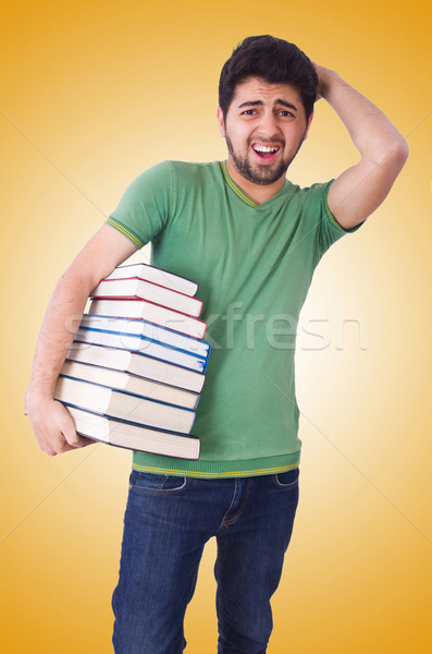Student with lots of books on white Stock photo © Elnur