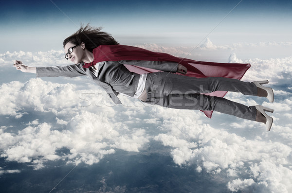 Superwoman flying above the skies Stock photo © Elnur
