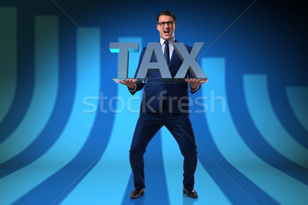Businessman struggling with high taxes Stock photo © Elnur