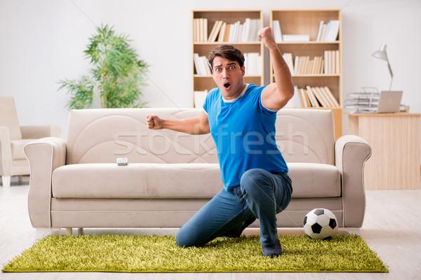 Stock photo: Man watching football at home