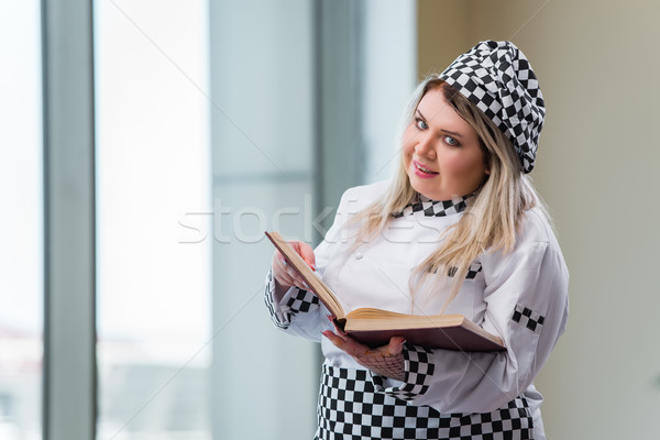 Young chef cook working in the kitchen Stock photo © Elnur