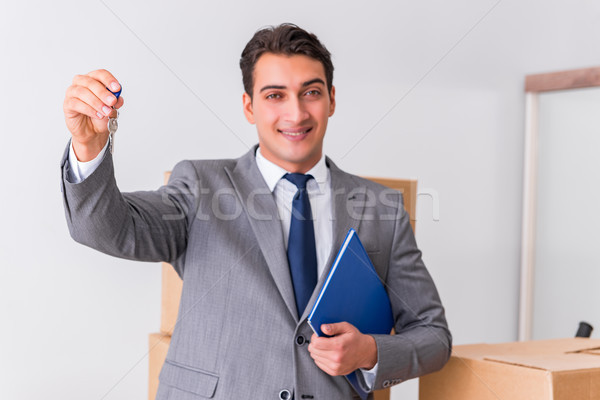 Real estate agent with key from new house Stock photo © Elnur