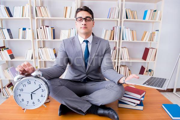 бизнесмен студент Lotus положение будильник ноутбука Сток-фото © Elnur