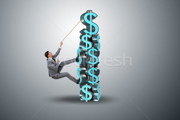 The businessman climbing dollar challenge tower Stock photo © Elnur