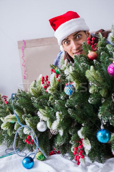 Człowiek cierpienie kac christmas strony szkła Zdjęcia stock © Elnur