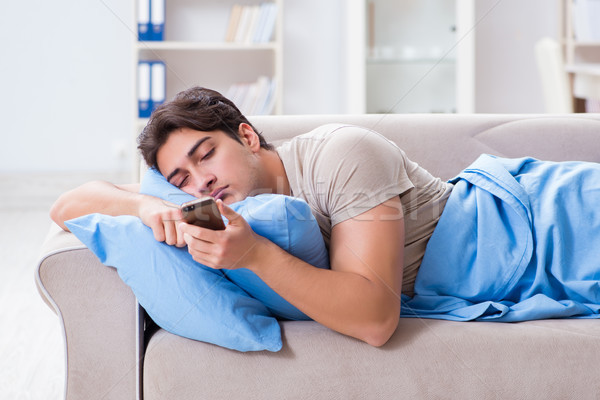 Man addicted to his mobile phone in bed Stock photo © Elnur