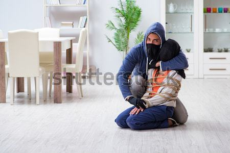 Armed man assaulting young woman at home Stock photo © Elnur