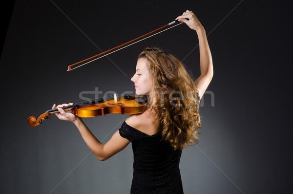 Attractive woman with cello in studio Stock photo © Elnur