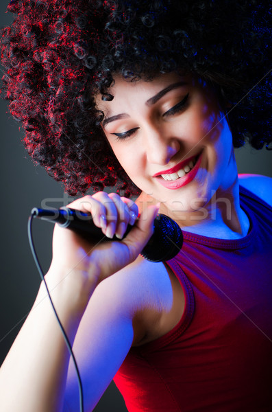 Female performer at disco with mic Stock photo © Elnur