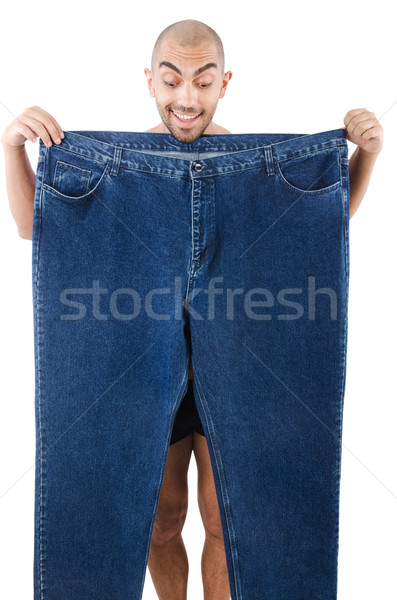 Man in dieting concept with oversized jeans Stock photo © Elnur