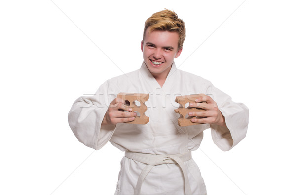 Funny karate man breaking bricks isolated on white Stock photo © Elnur