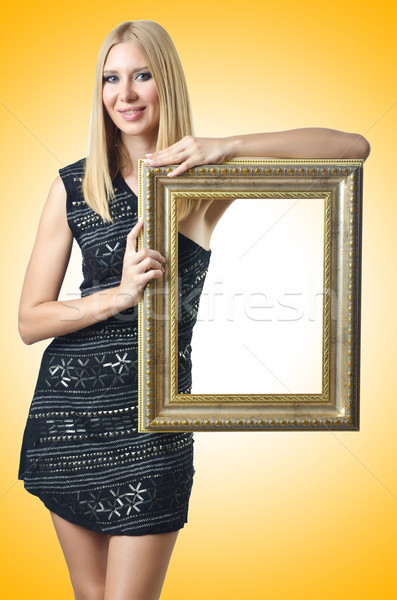 Woman holding picture frame on white Stock photo © Elnur