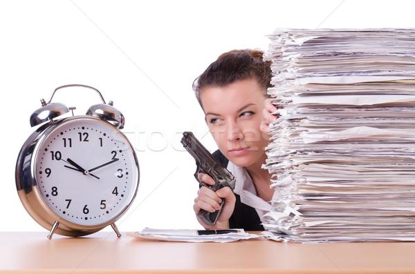 Woman with gun under stress from deadlines Stock photo © Elnur