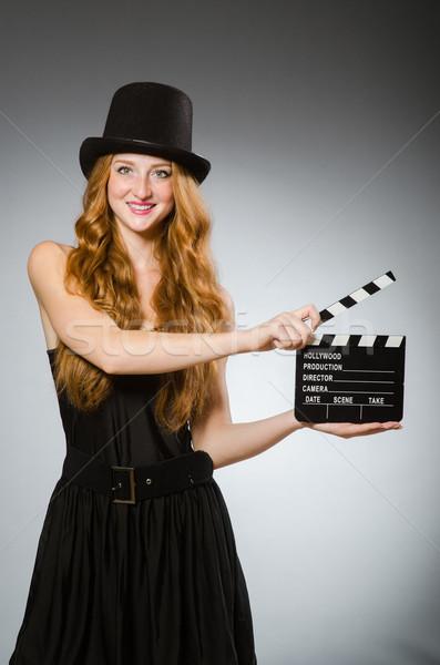 Nő film tábla visel kalap mosoly Stock fotó © Elnur