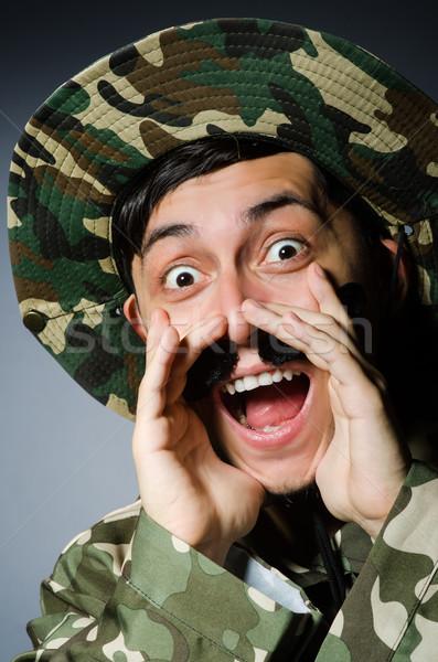 Funny żołnierz wojskowych człowiek tle bezpieczeństwa Zdjęcia stock © Elnur
