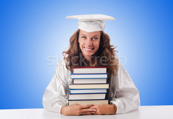 Happy graduate with lots of books on white Stock photo © Elnur