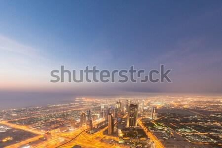 Stock photo: Panorama of night Dubai during sunset