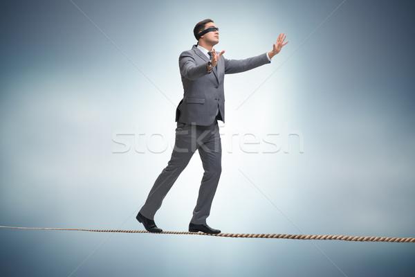 Férfi sétál szoros kötél háttér üzletember Stock fotó © Elnur
