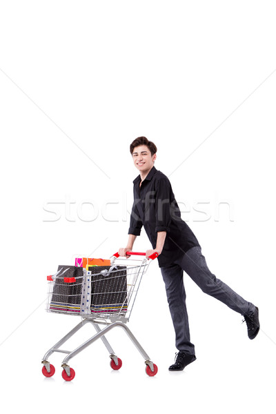 Young man with shopping cart and bags isolated on white Stock photo © Elnur