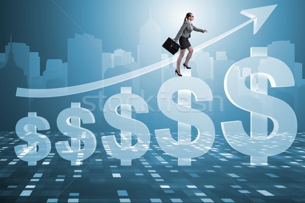 The businesswoman in american dollar concept Stock photo © Elnur