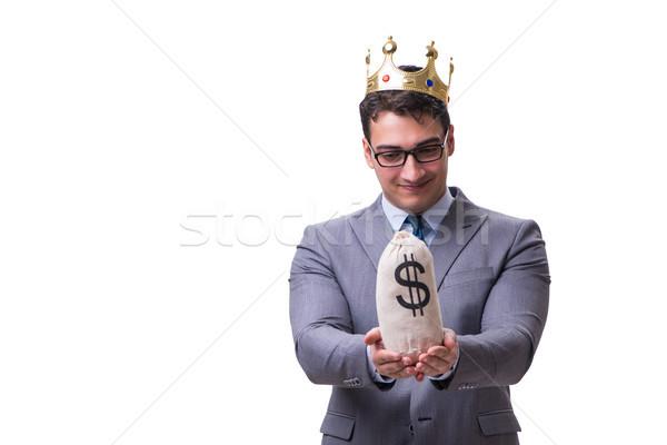 King businessman holding money bag isolated on white background Stock photo © Elnur