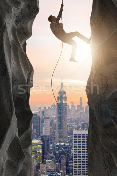 Businessman overcoming challenges in business concept Stock photo © Elnur