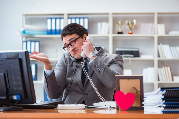 Businessman in saint valentine concept in office Stock photo © Elnur