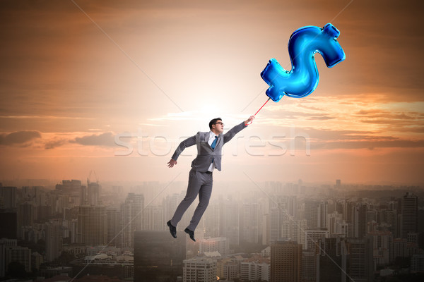 Empresário voador cifrão inflável balão dinheiro Foto stock © Elnur
